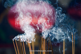 smoke of burning incense in chinese temple
