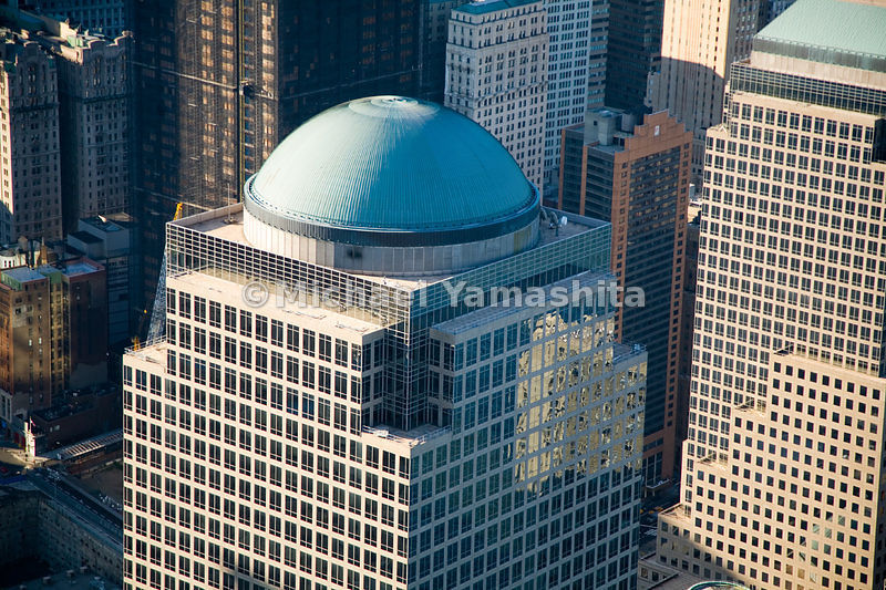 The Cesar Pelli-designed domed tower of 2 World Financial Center is home to Merrill Lynch, and is part of a complex of offices, restaurants and retail spaces, overlooking Battery Park City's North Cove marina.  Manhattan, New York City.