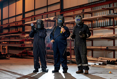Dalmarnock, Glasgow.12.3.15.Cuningar Loop artist in residence Rob Mulholland (bands around work suit arms) working alongside local men Steven Milligan (21 - Glasses) and Robert Kennedy (29) preparing iron work for use at the Cuningar Loop project...More info from Susan Ferrier at Golley Slater..0131 220 8785  |  0141 204 7800 | 07918690604.Golley Slater Scotland, 3 Queen Street, Edinburgh, EH2 1JE / 38 Queen Street, Glasgow, G1 3DX..www.golleyslater.com..Picture Copyright:.Iain McLean,.79 Earlspark Avenue,.Glasgow.G43 2HE.07901 604 365.photomclean@googlemail.com.www.iainmclean.com.All Rights Reserved.Strictly No Syndication.
