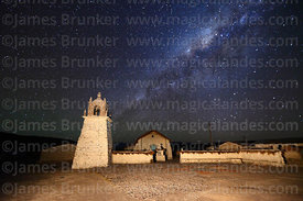 Milky Way galactic core above Guallatiri village church and square, Las Vicuñas National Reserve, Region XV, Chile