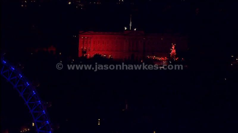Aerial footage of the London Eye and Buckingham Palace at night, London, England, UK