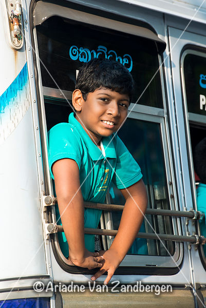 Boy looking out of a bus window, Galle fort, Galle, Sri Lanka