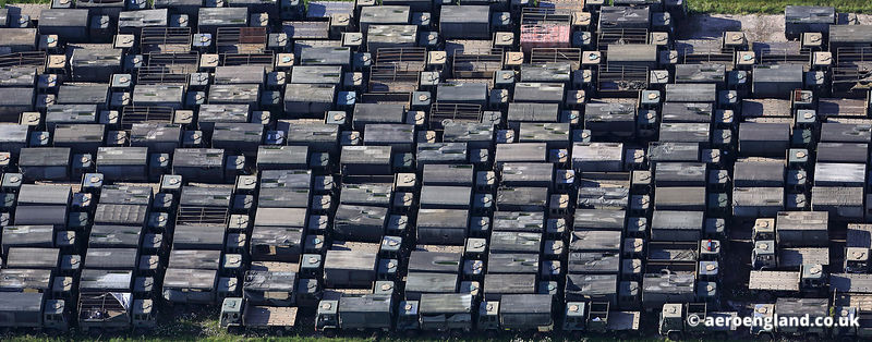 aerial photograph showing Leyland 4-tonne trucks awaiting disposal.
