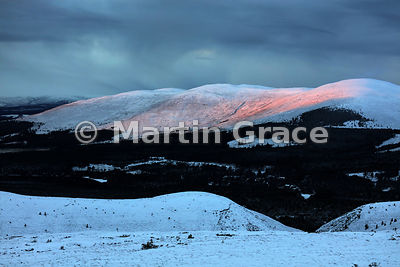 Late afternoon sunshine adding rouge to the cheek of Meall a'Bhuachaille, Cairngorm Mountains, Scotland
