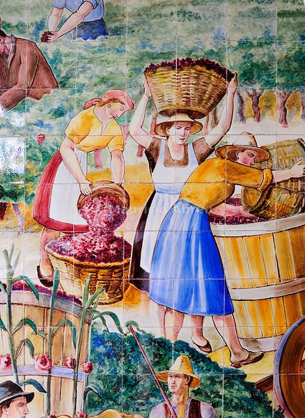 Detail of a panel of tiles representing the harvest of the grapes. Painted in 1956 in the Outeiro atelier. Águeda. São João Wine Cellars, Bairrada. Portugal (no property release)