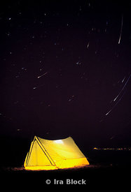 Yellow tent with star trails at night, Arizona