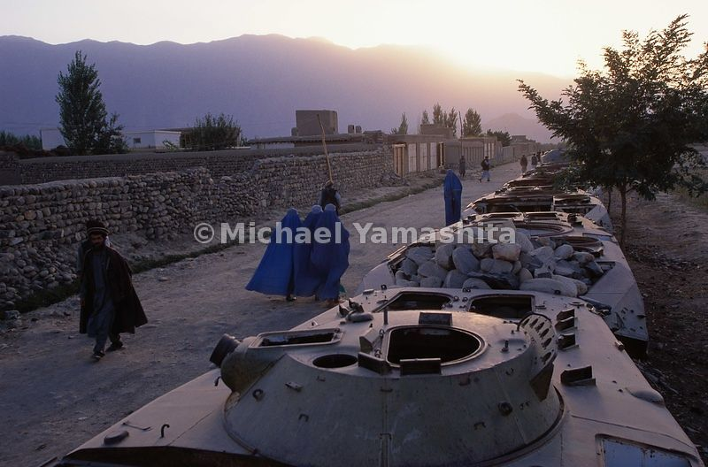 Rows of Russian armored vehicles rust in the streets and feilds of Afghanistan.