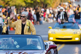 UI President Sally Mason rides in the University of Iowa homecoming Parade on Washington St in Iowa City on Friday September 28, 2012. (Justin Torner/Freelance)