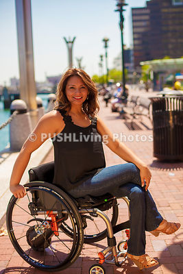 Woman using a wheelchair on a coastal promenade