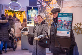 Jehovah Witnesses offer literature to people entering the White Magic Christmas Market