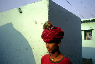 India - New Delhi - A boy walks through Shadipur on his way to a show
