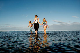 Young Nordic woman and children in the water 3