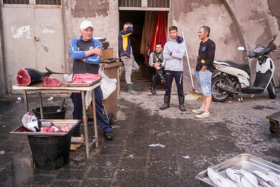 Stallholders at the Mercato della Pescheria Market wait for customers