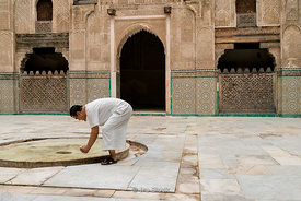 A man inside the Medersa Bou Inania in Fes, Morocco