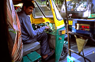 India - New Delhi - An autorickshaw driver