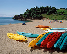 Kayaks on Blackpool Sands, near Dartmouth, South Hams, South Devon, England.