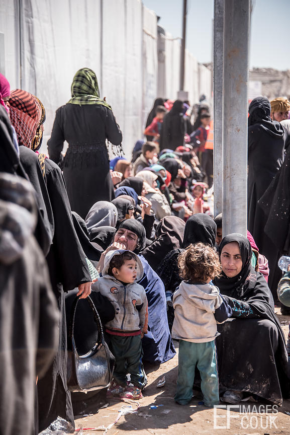 The Women's Queue In The Transit Area At Hamam al Alil IDP Camp. When They Eventually Reach The Front, They Will Get A Basket Of Beans, Canned Meat, Dates, Biscuits, Chickpeas And Water. One Per Family.