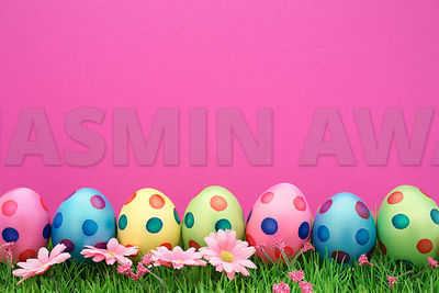 Cute easter eggs in a row with pink background and copy space