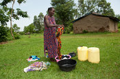 Woman doing her washing by hand, Bumala, Kenya.