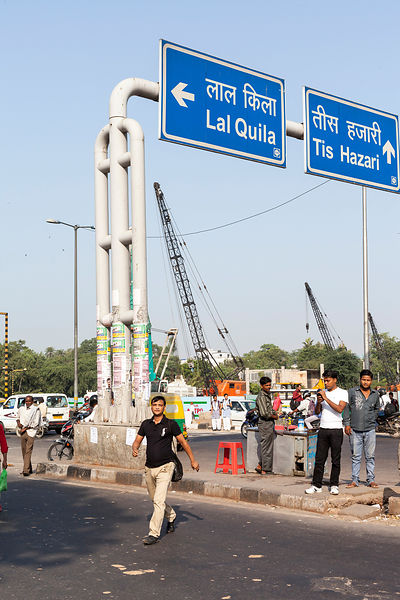 India - Delhi - A man crosses the road amidst traffic and construction work by the ISBT bus station