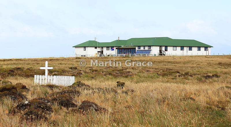 Sea Lion Island Lodge, with the grave of Alexander Dugas, a Frenchman who committed suicide on the island in late 1929 or early 1930, Sea Lion Island, Falkland Islands