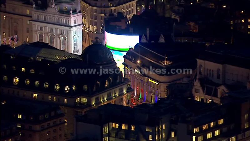 Aerial footage over Piccadilly Circus and surrounding area at night, London, England, UK