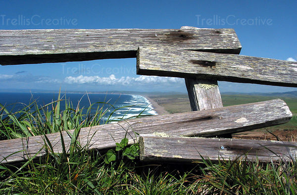 Looking at the Pacific Ocean through and old wooden fence at Point Reyes National Seashore