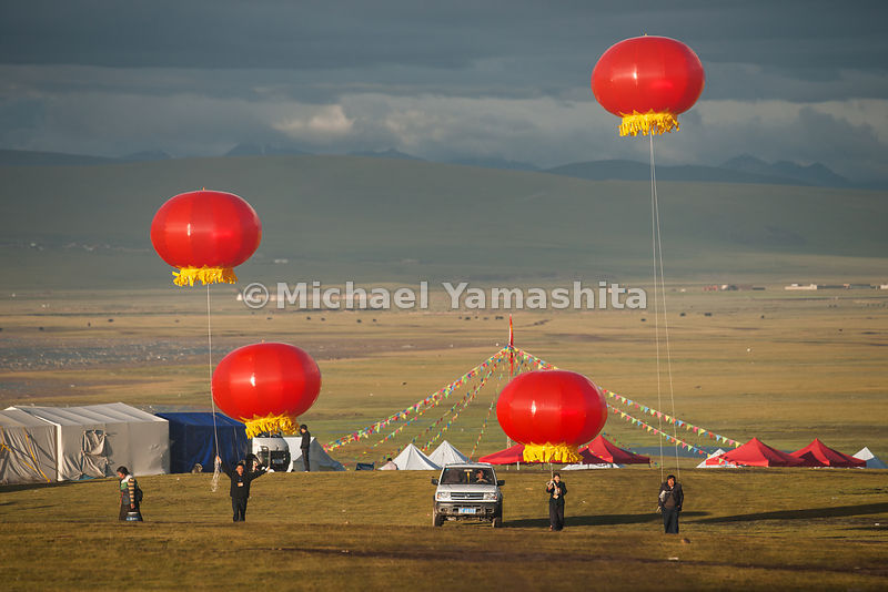 Vermillion-colored balloons announce that the equine festivities are about to begin.