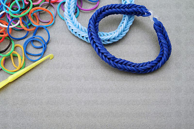 Jewelry made from elastic rubber bands with copy space