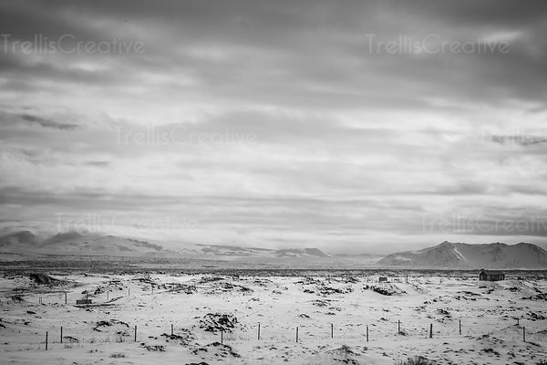 A dramatic black and white photo of a winter landscape in Iceland