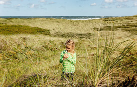 Danish girl playing in the dunes in Thy 12