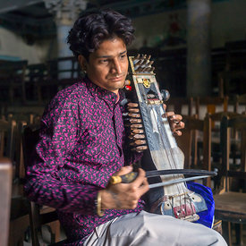 Umesh Mishra, 26, a sarangi virtuoso, tunes his instrument before a concert at the Nrityagopal Smriti Mandir