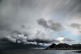 Storm clouds over the sea and mountain
