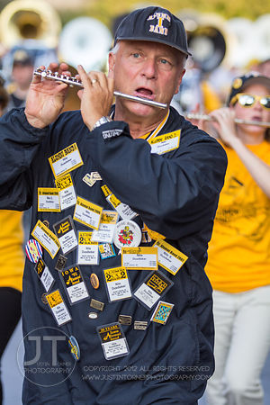 Nile Dusdieker of North Liberty marches with the Alumni Band in the 2012 University of Iowa homecoming Parade on Washington St in Iowa City on Friday September 28, 2012. (Justin Torner/Freelance)