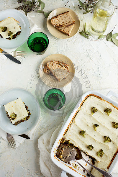 Black Lentil Charred Broccoli Shepherd's Pie served with bread and white wine.