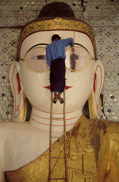 Cleaning spectacles of Spectacled Buddha