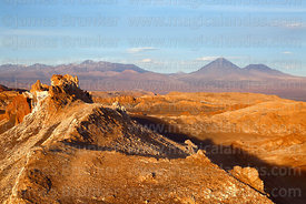 View over Valle de la Luna from Achaches viewpoint to Licancabur (centre) and Juriques (R) volcanos, Los Flamencos National Reserve, Chile