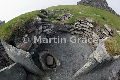 Oldest settlement structures at Jarlshof, dating from the Bronze Age and early Iron Age, with quern, Sumburgh, Shetland