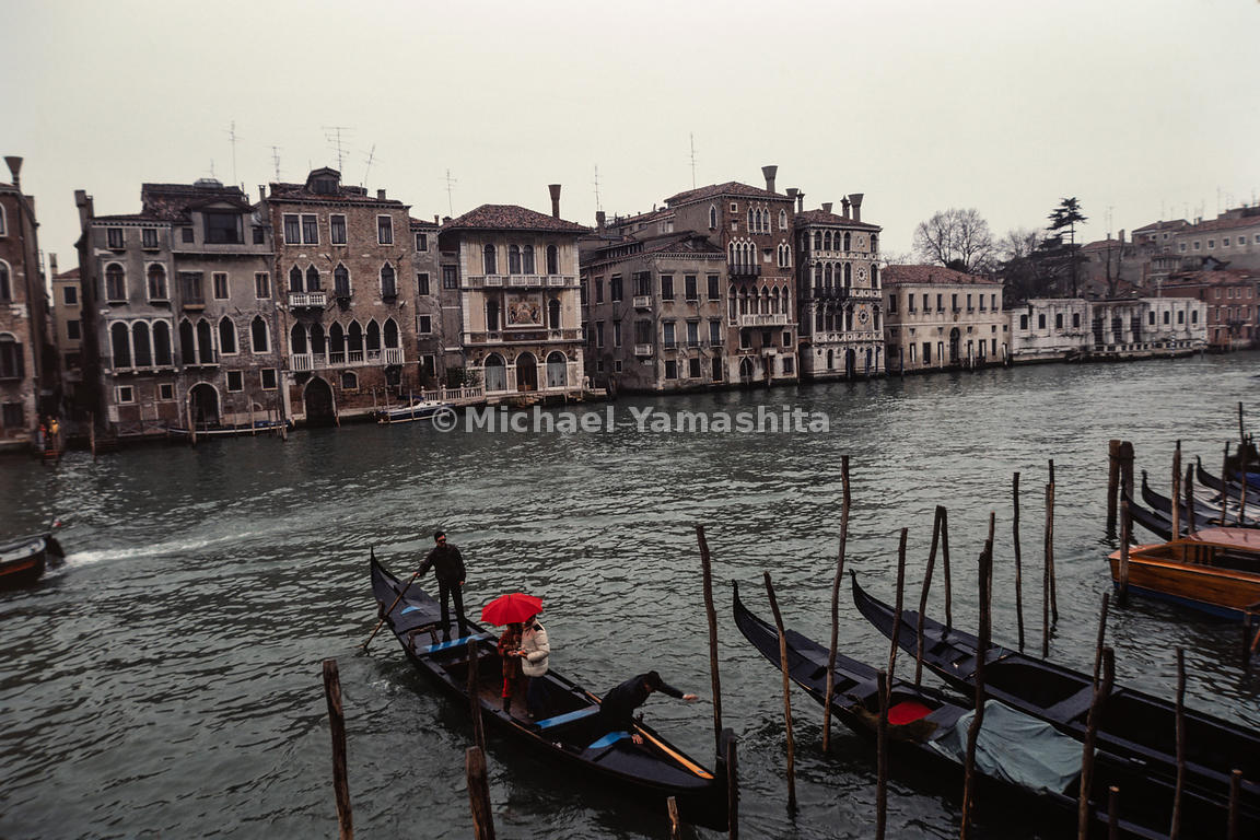 Traveling by gondola through the canals is a common form of transportation in Venice. Italy, April, 1982.