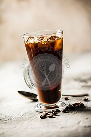 Iced coffee on rustic table