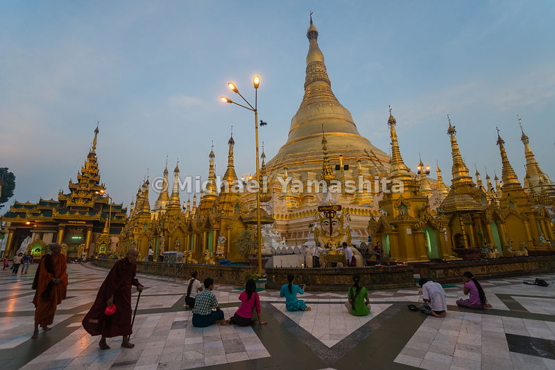 The devout kneel down before Shwedagon Pagoda, widely considered Myanmar's greatest treasure, a massive gold-plated wonder topped at its pinnacle with a 76-carat diamond.