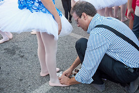 A girl wearing ballet toe shoes at Festa Madonna del Rosario in Portogruaro, Italy.