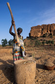 Woman pounding millet, Songo, Dogon Country, Mali