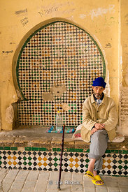 A local poses for a photograph in Medina in Fes, Morocco.