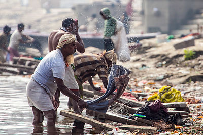 Workers do laundry in the Ganges River, Varanasi, India.