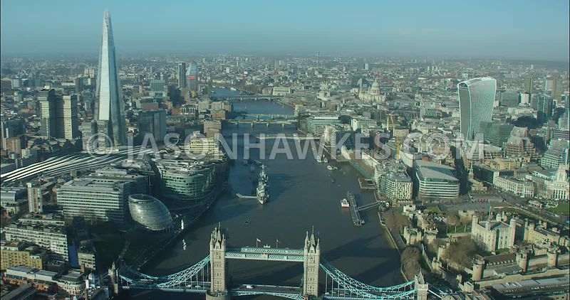 London Aerial footage, Tower Bridge towards The Shard.
