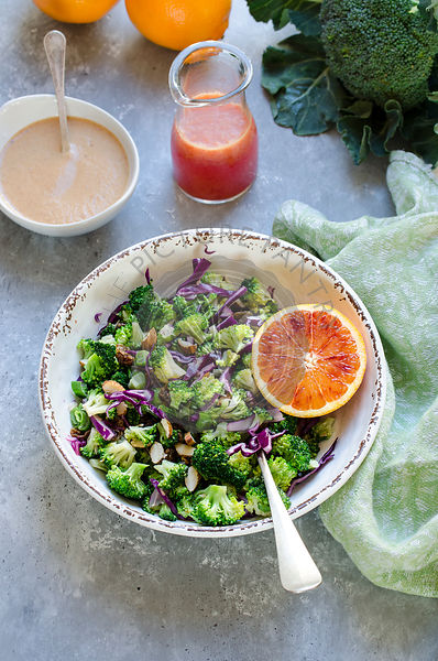 Broccoli and red cabbage salad with almond and orange dressing