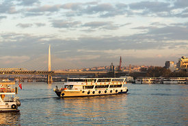 Ferries in the Golden Horn, with the Halic Bridge in Eminönü, Istanbul.