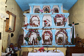 Altar inside church decorated for San Santiago festival , Taquile Island , Peru