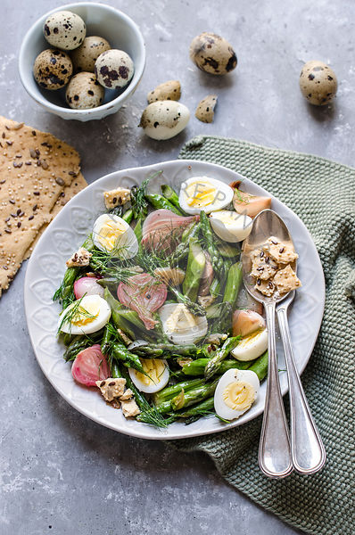 Asparagus and quail egg salad with dried focaccia
